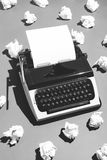 Oldschool typewriter and creased paper. Royalty Free Stock Images