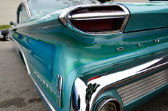 Oldsmobile in Blue - shiny chrome rear quater color Royalty Free Stock Photo