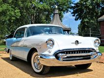 1955 Oldsmobile. A blue and white 1955 Oldsmobile Holiday 88 classic automobile Stock Image