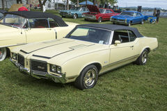 Oldsmobile cutlass. Front side view of oldsmobile cutlass convertible in display during the concours d`elegance chambly, July 16-17, 2016 Royalty Free Stock Images