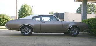 Oldsmobile Cutlass Supreme. The Oldsmobile Cutlass Supreme is a mid-size car produced by Oldsmobile between 1966 and 1997. It was positioned as a premium Royalty Free Stock Photos