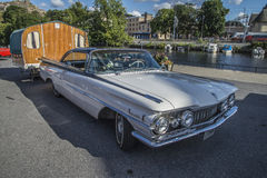 1959 Oldsmobile Dynamic 88 coupe, with caravan Royalty Free Stock Photo