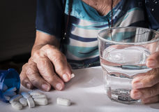 Oldster taking daily medication dose at home. Andalusia, Spain Royalty Free Stock Photography