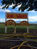 OldTime Air & Water. Gas station air water refill small town colorful natural Stock Photos