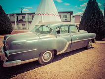 Oldtime Vehicle Wigwam Motel Arizona. One of the many vintage cars that are parked in front of Motel Rooms made of TeePees royalty free stock photography