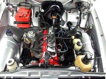 Oldtimer car engine. Front of oldtimer chrome car engine Stock Image