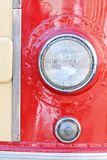 Oldtimer  car headlight. Retro style. red and yellow paint Stock Photography
