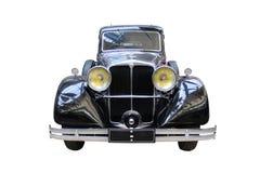 Classic oldtimer car isolated on white. Oldtimer car isolated on white background.  Classical historical retro car on a white background Royalty Free Stock Image
