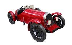Oldtimer car isolated on white. Red oldtimer car isolated on white. Classical veteran retro car Stock Images