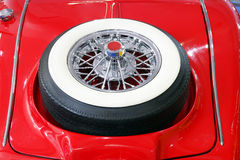 Oldtimer car with spare tire. Backside of oldtimer car with spare tire Stock Image