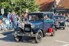 Oldtimer cars in a Dutch countryside parade Royalty Free Stock Photo