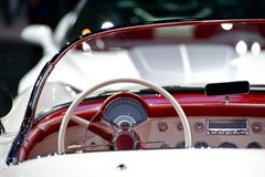 Oldtimer Convertible Dash. Cool American 50s Oldtimer Dashboard - Steering Wheel. Red-White Interior Royalty Free Stock Images