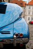 Oldtimer detail. Closeup view on a rear part and tail light of a blue classic car stock images