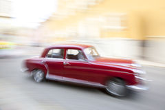 Oldtimer driving fast in city. A oldtimer driving fast in city Stock Photos