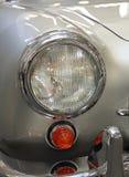 Oldtimer Headlight. Round Headlight at Silver Oldtimer Car Royalty Free Stock Photography