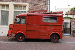 Oldtimer. The historic red van with luggage rack royalty free stock images