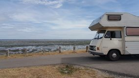 Oldtimer Mercedes RV at the beach stock photo