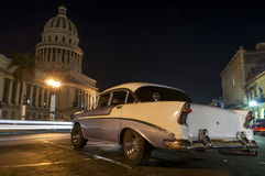 Oldtimer parked in front of cuban Capitolio Royalty Free Stock Image