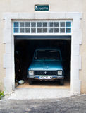 Oldtimer parked in garage. An oldtimer Renault parked in a garage somewhere in the Provence Stock Photos