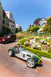 Oldtimer passes the lombard street, Royalty Free Stock Images
