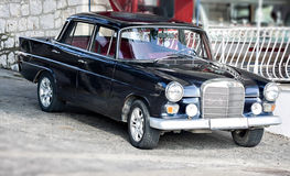 Oldtimer retro vintage car limousine at street Stock Image
