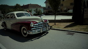 Oldtimer standing at the side of the road before driving off stock video footage