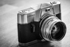 Oldtimer. The Voigtländer Ultramatic CS was the first 35mm leaf shutter SLR camera with TTL metering. The design of the not too heavy camera was derived from royalty free stock image