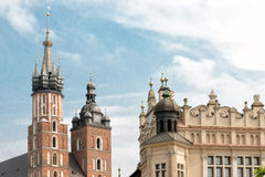 Oldtown of Krakow. Marketsquare in Krakow with the Mariacki church and the cloth halls royalty free stock photography