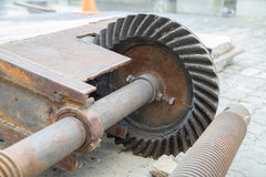 Ole greasy gears on the floor Stock Photography