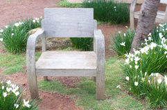 Ole wooden chairs on lush green lawn Stock Images
