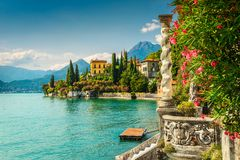 Oleander flowers and villa Monastero in background, lake Como, Varenna. Famous luxury villa Monastero, stunning botanical garden decorated with mediterranean royalty free stock photos