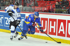Oleg Tymchenko in pursuit of the puck Royalty Free Stock Photography