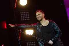 Oleh Sobchuk, Ukrainian pop-rock group SKAI, turns microphone to fans audience at Roshen Fountain Season closing concert. Vinnytsia, Ukraine - 13.10.2018: Oleh stock images