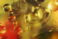 Olej krople w wodzie abstrakcyjny tło Fotografia Stock