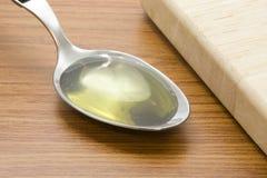 olej kuchenny łyżka Obrazy Stock
