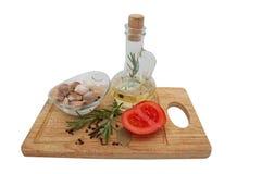 Olej z pikantność i pomidorem zdjęcie stock