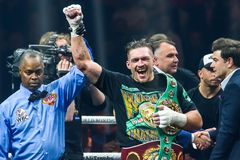 Oleksandr Usyk announce as winner of Super Series semi final fight royalty free stock image