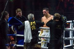 Oleksandr Usyk gets water splashes at pause, during fight. stock photography