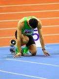Oleksiy Kasyanov wordt klaar aan de 60 meters streepje Stock Foto