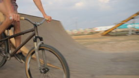 OLENEVKA RUSSIA - JUL 30 2016: Bmx riders are practicing extreme stunts on the bike in the ramp. Bmx-vert stock footage