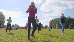 Female boxing in a park on background blue sky, healthy lifestyle stock video footage