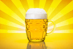 Olf fashioned mug with fresh, foamy beer. Glass mug with fresh, foamy beer on backlit yellow retro background Stock Image
