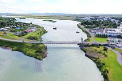 Selfoss town is staying at the river Olfusa