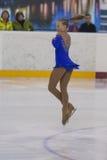 Olga Chesnakova de Rússia executa o programa de patinagem livre das meninas da classe IV do ouro no campeonato nacional da patina Imagens de Stock Royalty Free