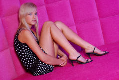 Olga in a pink room. Young woman posing in a pink room Royalty Free Stock Photo