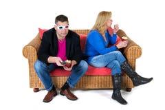 Olhando a televisão 3D Fotos de Stock Royalty Free