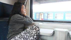 Olhar da mulher do trem Fotografia de Stock Royalty Free