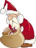 Olhar de Papai Noel no saco Imagens de Stock Royalty Free