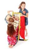 Olhar de três meninas das amigas no espelho Fotos de Stock Royalty Free