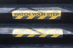 Olhe seu sinal da etapa em escadas Fotografia de Stock